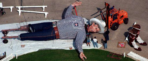 Workers attached the head of Big Tex in 1998 at the State Fair of Texas in Fair Park. Big Tex was wearing a custom-made Williamson-Dickie wardrobe, size 70 Justin boots and a 75  gallon cowboy hat.