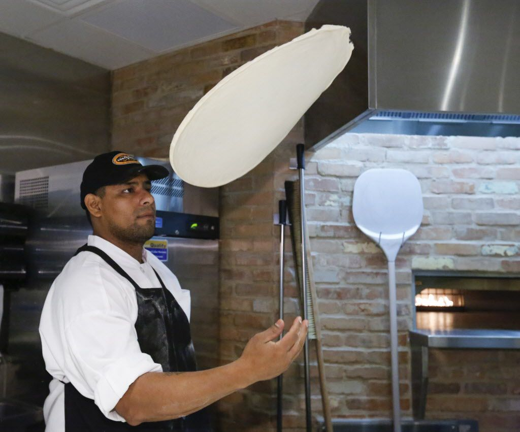 Louis Sanchez tosses the dough for a personal pizza Monday December 14, 2015, at the  new Coal Vines located across from the Omni Dallas Hotel.  (Ron Baselice/The Dallas Morning News)