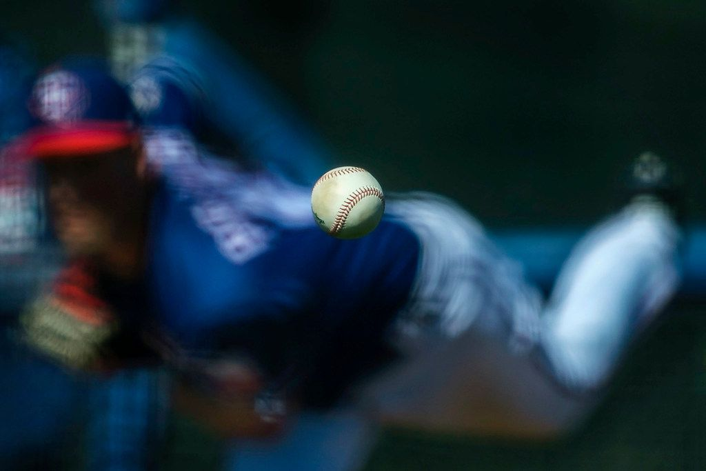 FILE - Texas Rangers pitcher Joe Palumbo throws live batting practice during a spring training workout at the team's training facility on Wednesday, Feb. 20, 2019, in Surprise, Ariz..