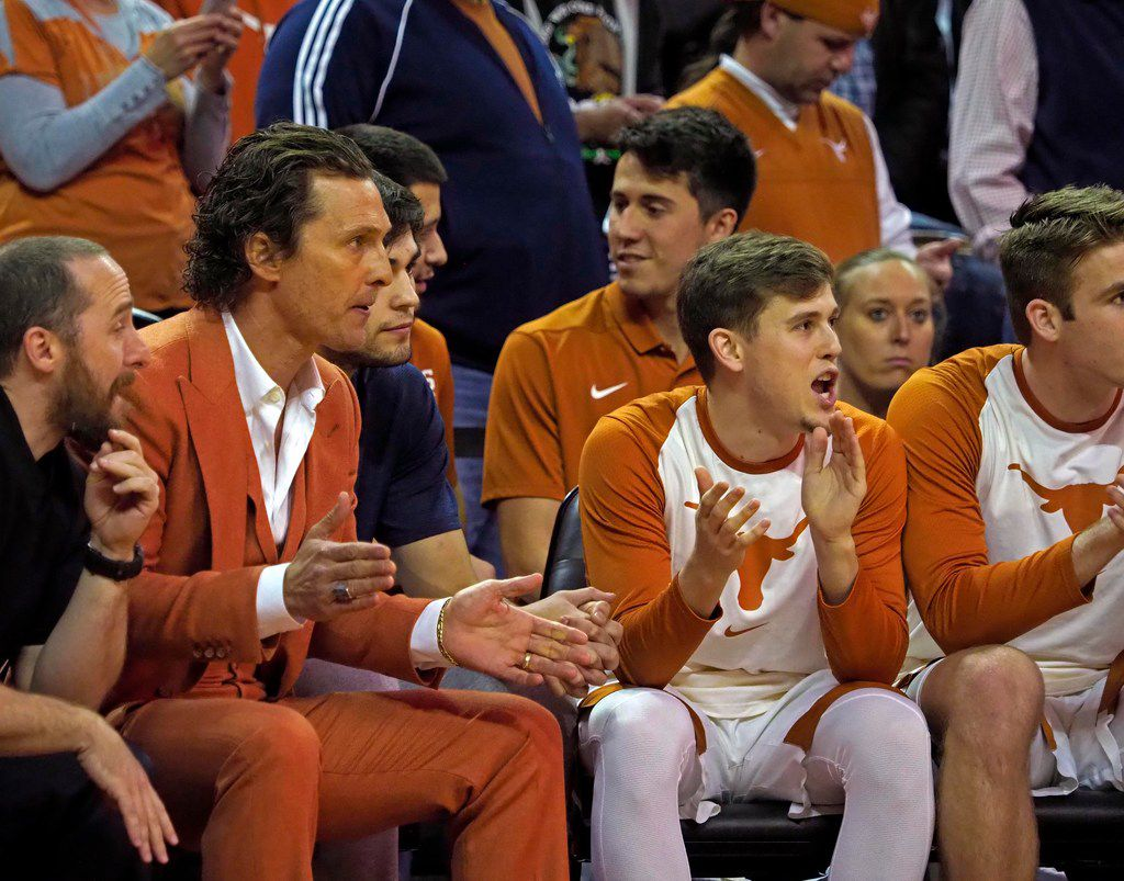 Texas fan Matthew McConaughey, second from left, cheers on the Texas Longhorn team from their bench during the first half of an NCAA college basketball game against Kansas State, Tuesday, Feb. 12, 2019, in Austin, Texas. (AP Photo/Michael Thomas)