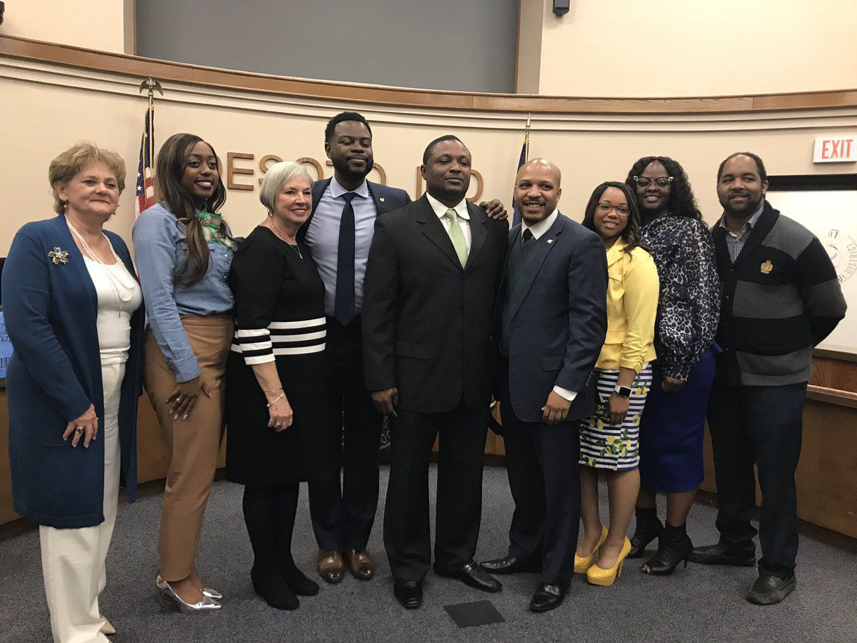 Claude Mathis (center with green tie) with the DeSoto school board.