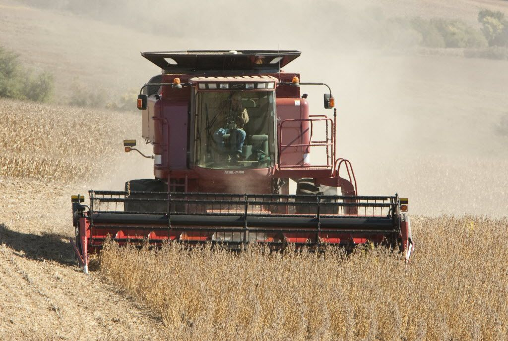 Lemar Vogler of Louisville, Neb., harvested soy beans in a field near South Bend, Neb., in 2009. Commodities trading may seem appealing, but the Fool says the risk isn't worth it for most people.