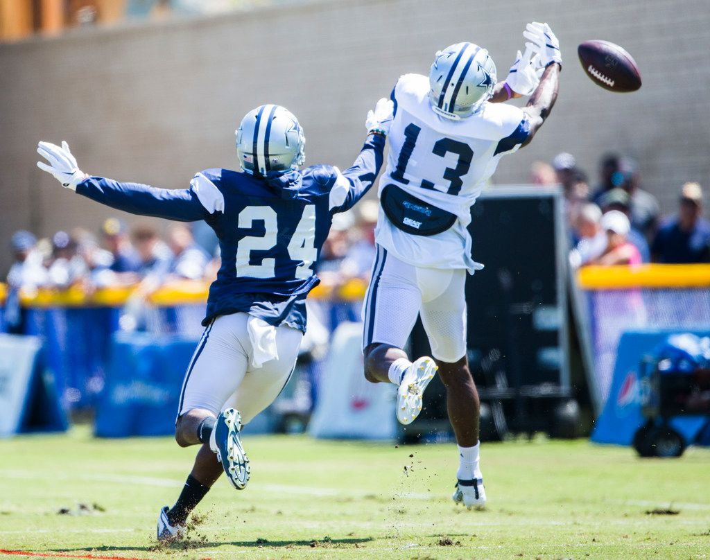 Dallas Cowboys wide receiver Michael Gallup (13) misses a catch while cornerback Chidobe Awuzie (24) defends during a morning practice at training camp in Oxnard, California on Thursday, August 8, 2019. (Ashley Landis/The Dallas Morning News)