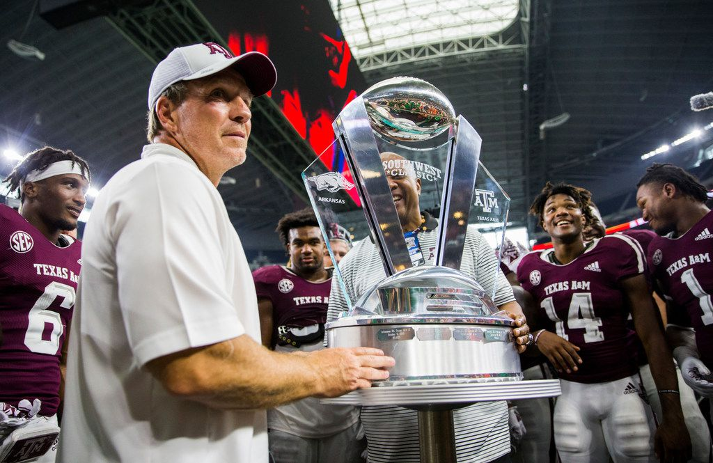 Texas A&M Aggies head coach Jimbo Fisher accepts the Southwest Classic trophy after a 24-17 win over Arkansas Razorbacks on Saturday, September 29, 2018 at AT&T Stadium in Arlington, Texas. (Ashley Landis/The Dallas Morning News)