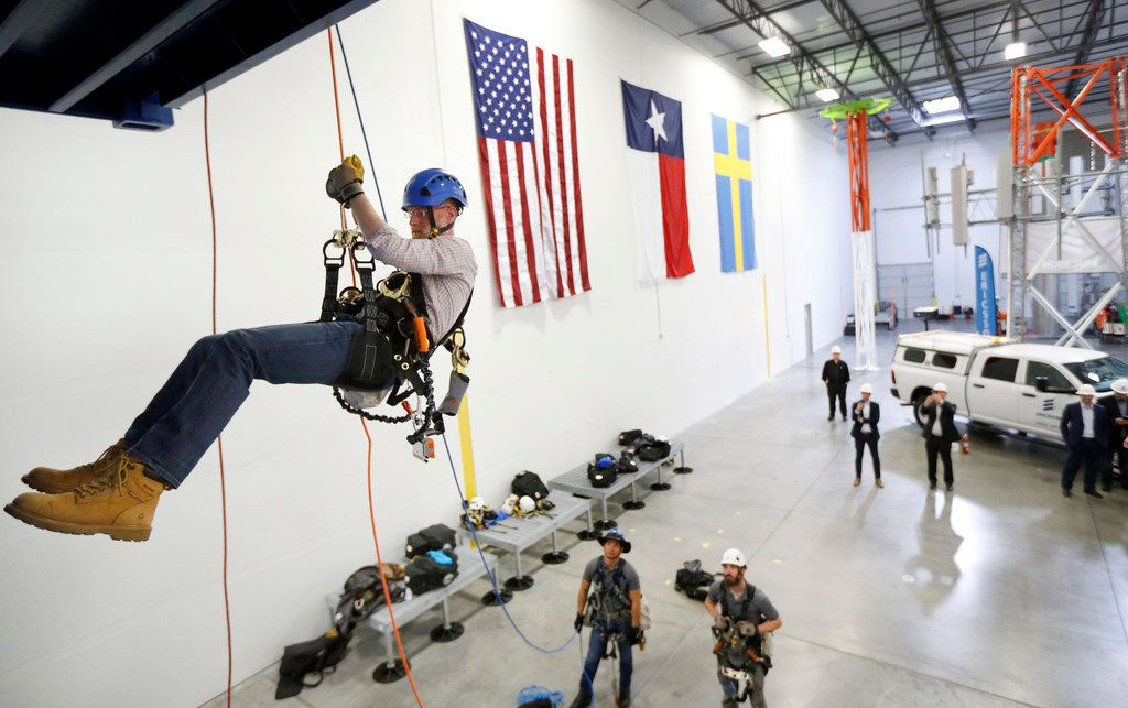 FCC commissioner Brendan Carr did a controlled descent while touring Swedish telecom company Ericsson's tower training facility in Lewisville. He also participated in a ribbon cutting for the center.