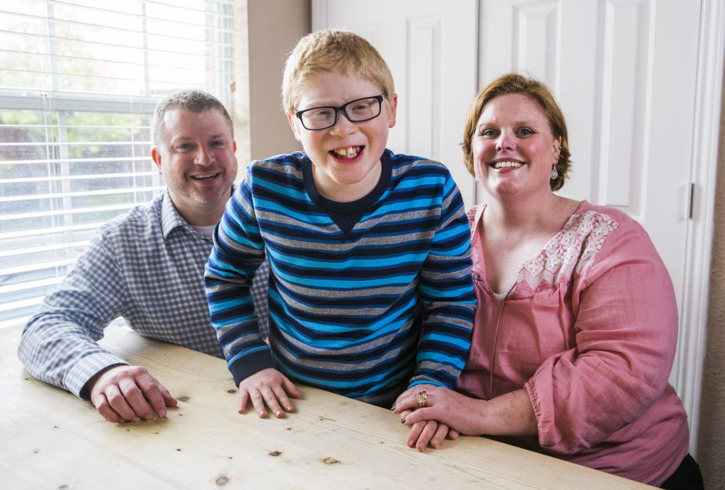 Ben Schneider, 11, poses for a portrait with his parents, Rob and Jenn Schneider, on Tuesday, April 12, 2016 in Frisco. Schneider is autistic, has impaired vision and has cerebral palsy.  He will have the chance to meet his favorite musician, Ben Folds, on Thursday when he performs at The Majestic. (Ashley Landis/The Dallas Morning News)