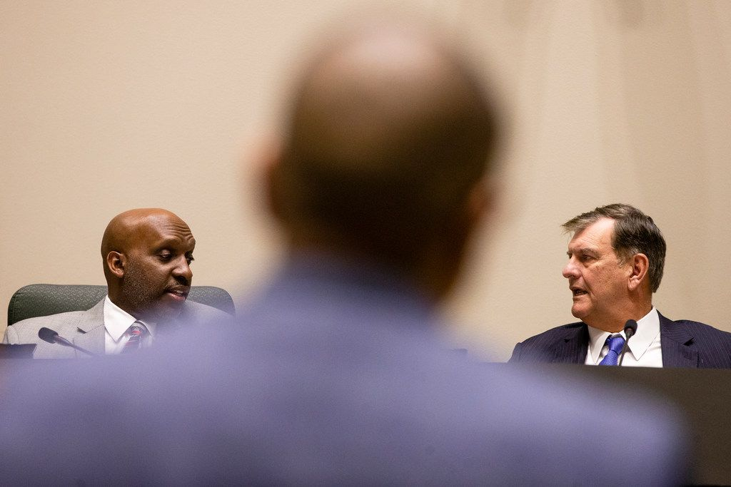 City Manager T.C. Broadnax talked to Mayor Mike Rawlings as Darren James, board president of Fair Park First, waited to address them at Dallas City Hall.