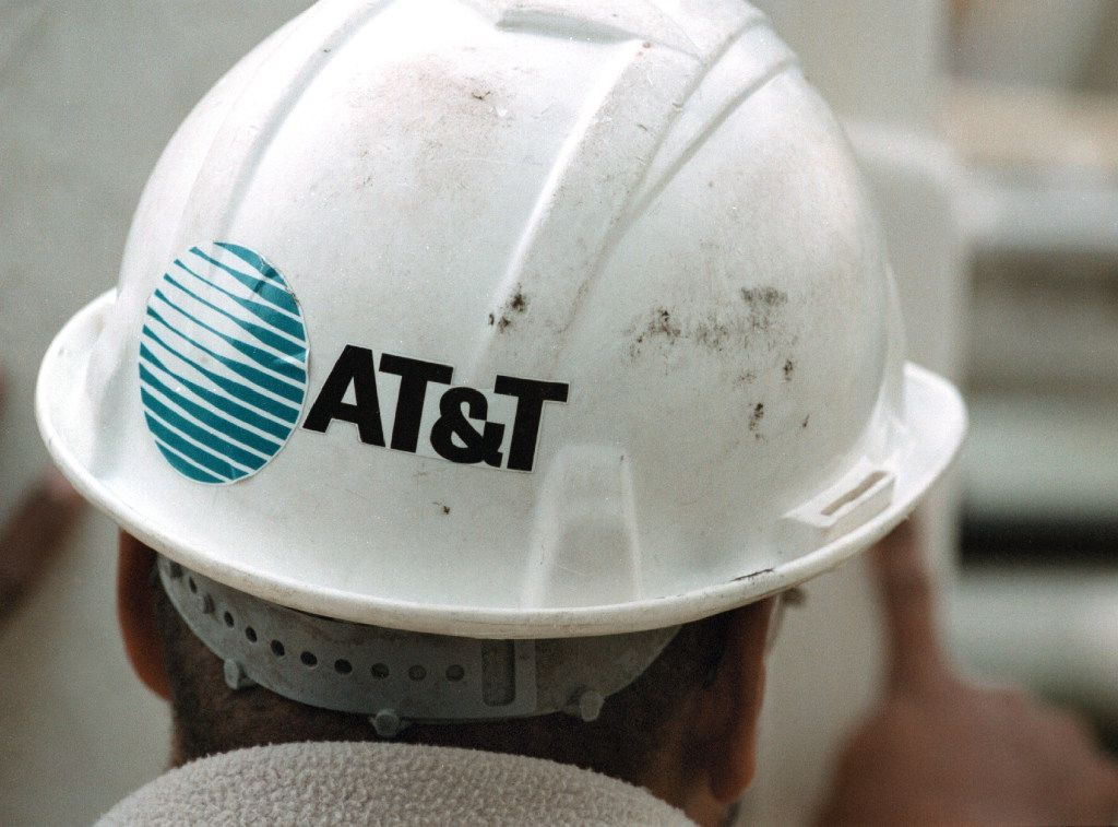 FILE - OCTOBER 22, 2016: It was reported that AT&T has reached a deal to acquire Time Warner for more than $80 billion October 22, 2016. 380909 04: The AT&T logo is seen on the safety helmet of advance-line technician Fred Murray October 26, 2000 in Des Plaines, Illinois. On October 25, 2000, AT&T Corp. announced that it was breaking itself up into four smaller companies for the third time since 1984, scrapping its vision of one-stop shopping for communications services, and dismantling a telephone and cable TV empire that took three years and more than $100 billion to build. The widely expected breakup will create four distinct entities, including an independent cable company and an independent wireless company, all operating under the AT&T brand name. (Photo by Tim Boyle/Newsmakers)