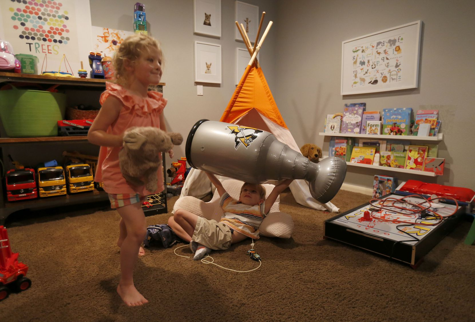 Will plays with his sister, Lauren, in the playroom at their home in McKinney, Texas, on Wednesday, June 20, 2018.