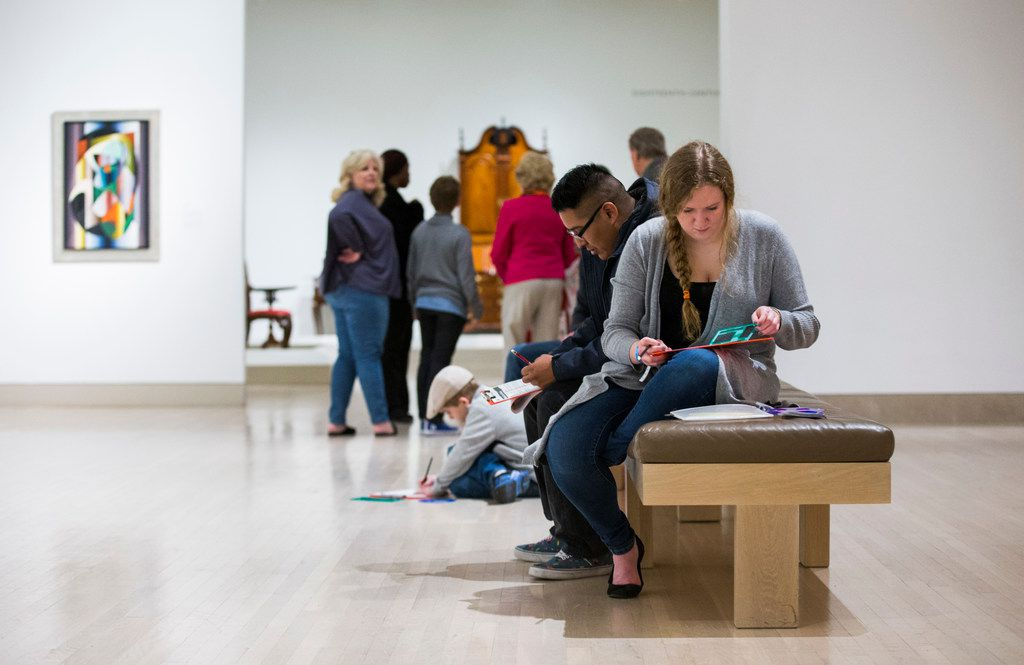 Sammi Oliphint, right, Erwynn Martinez, second from right, and other patrons participate in a pop-up art spot at the Dallas Museum of Art's Late Night at the DMA on Friday, February 16, 2018 in downtown Dallas. (Ashley Landis/The Dallas Morning News)