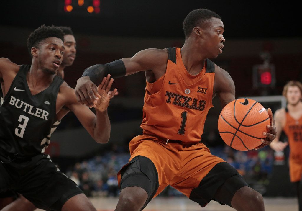 Butler's Kamar Baldwin (3) prevents Texas' Andrew Jones from driving the baseline in the first half of an NCAA college basketball game during the Phil Knight Invitational tournament in Portland, Ore., Thursday, Nov. 23, 2017. (AP Photo/Timothy J. Gonzalez) ORG XMIT: ORTG114