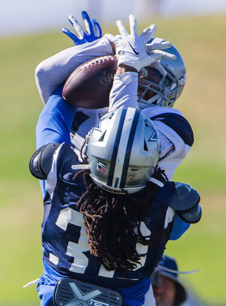 Dallas Cowboys cornerback Donovan Olumba (32) breaks up a catch by wide receiver Devin Smith (15) during an afternoon practice at training camp in Oxnard, California on Tuesday, August 13, 2019. (Ashley Landis/The Dallas Morning News)