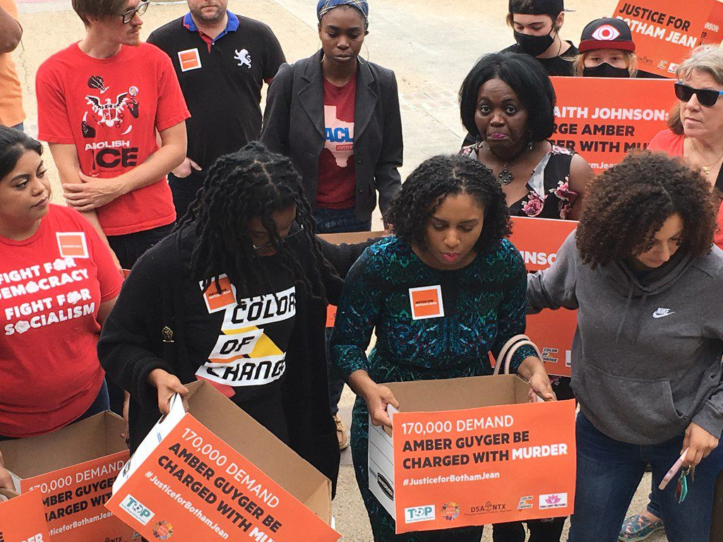 In September, Cynthia Johnson (center), Botham Jean's girlfriend, delivered signatures to District Attorney Faith Johnson's office with Clarise McCants of Color of Change (left) and Sara Mokuria (right) of Mothers Against Police Brutality.