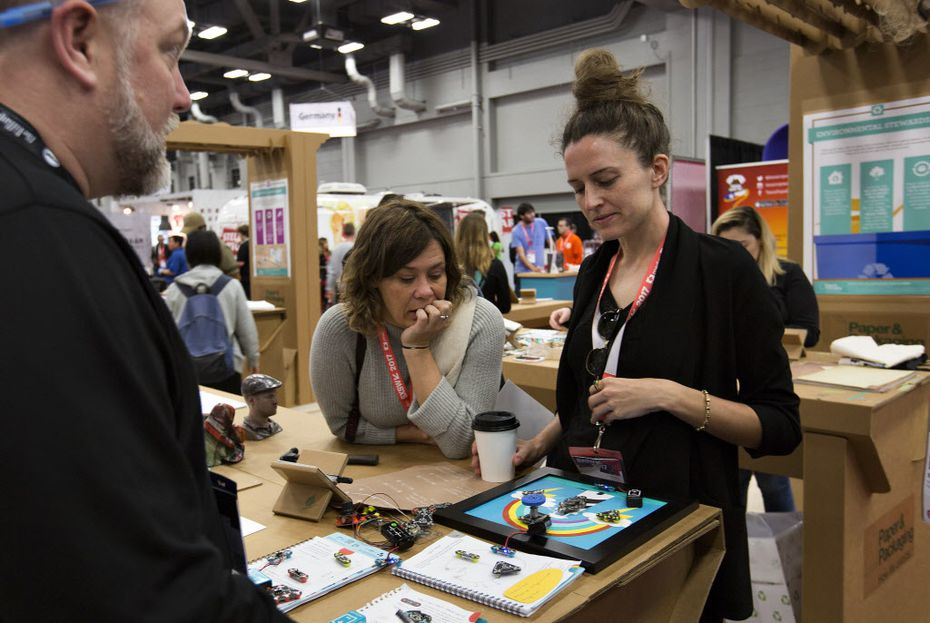 Julie Lee and her coworker Karla Courtney visited one of the low tech booths at SXSW. It explored the uses of paper.
