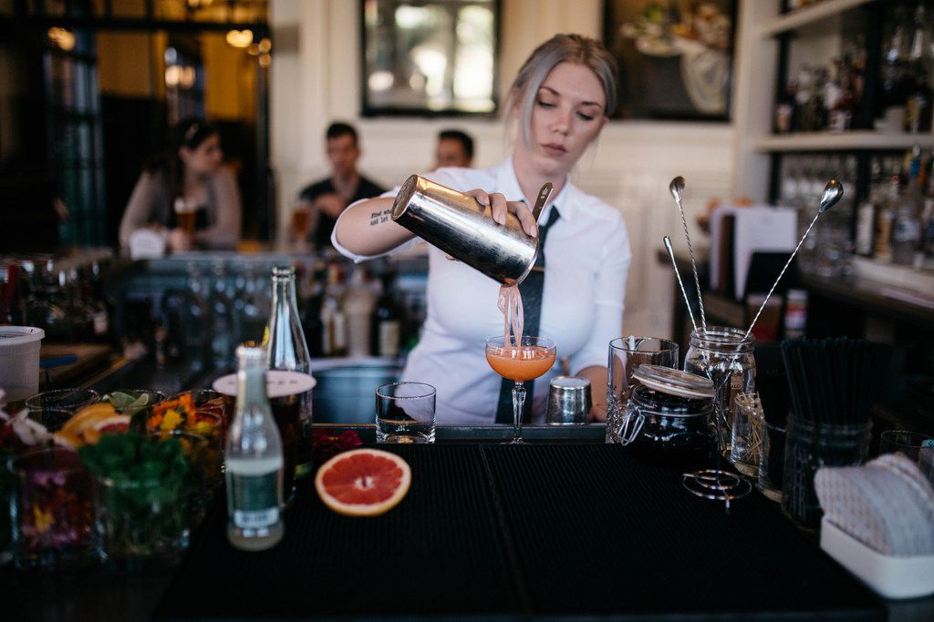 A bartender pours a drink at the Hotel Emma in San Antonio.