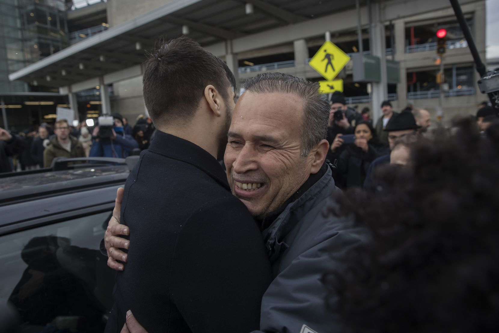 Hameed Khalid Darweesh, center, a former interpreter for the U.S. military in Iraq, embraces a supporter after his release from detention at John F. Kennedy International Airport in New York, Jan. 28, 2017.