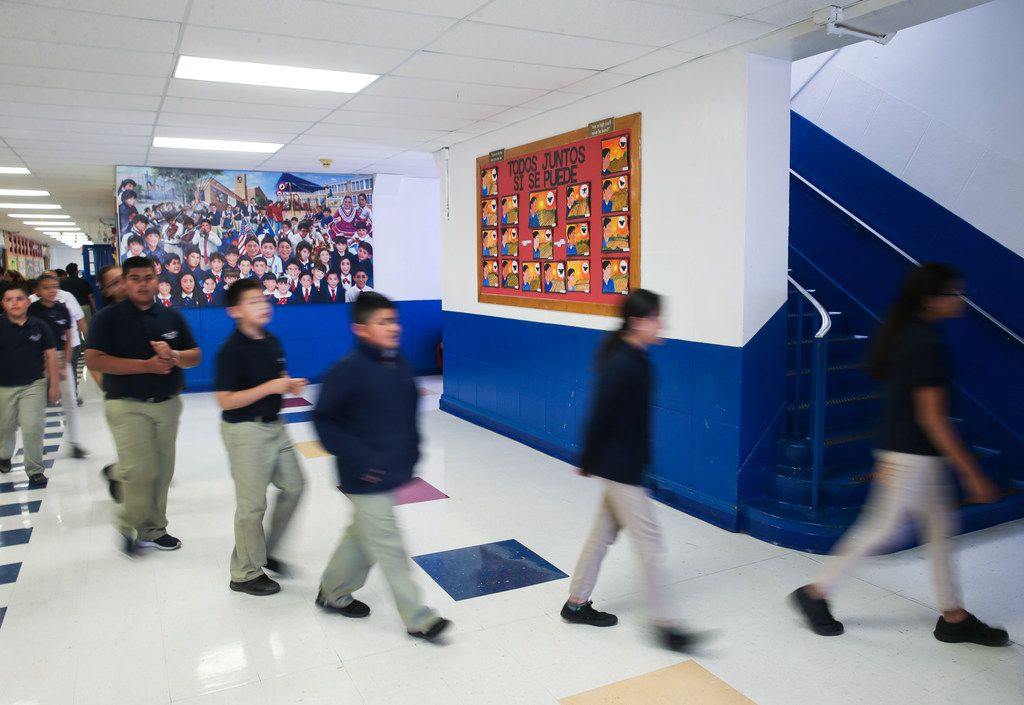 Students made their way to class at La Fe Preparatory School in El Paso on March 29, 2019.