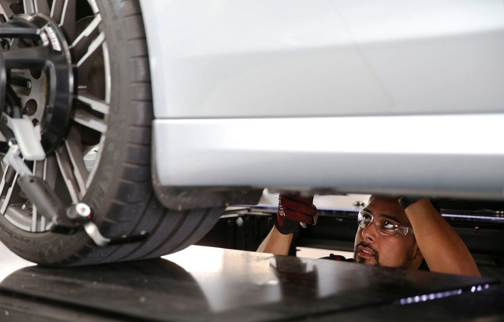 Service technician Adrian Ventura works on a Porsche at Porsche Grapevine. Park Place Dealerships, a nine-time winner, was our No. 18 large company last year.