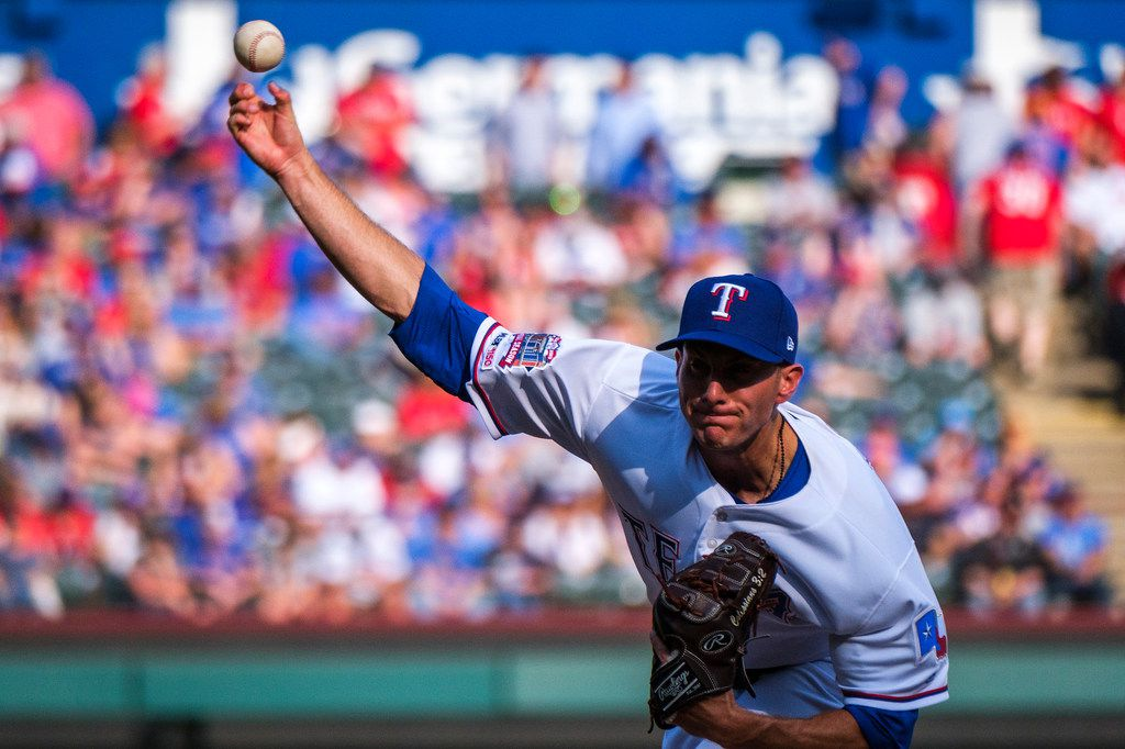 Texas Rangers starting pitcher Kyle Dowdy throws during the seventh inning against the Chicago Cubs at Globe Life Park on Thursday, March 28, 2019, in Arlington. (Smiley N. Pool/The Dallas Morning News)