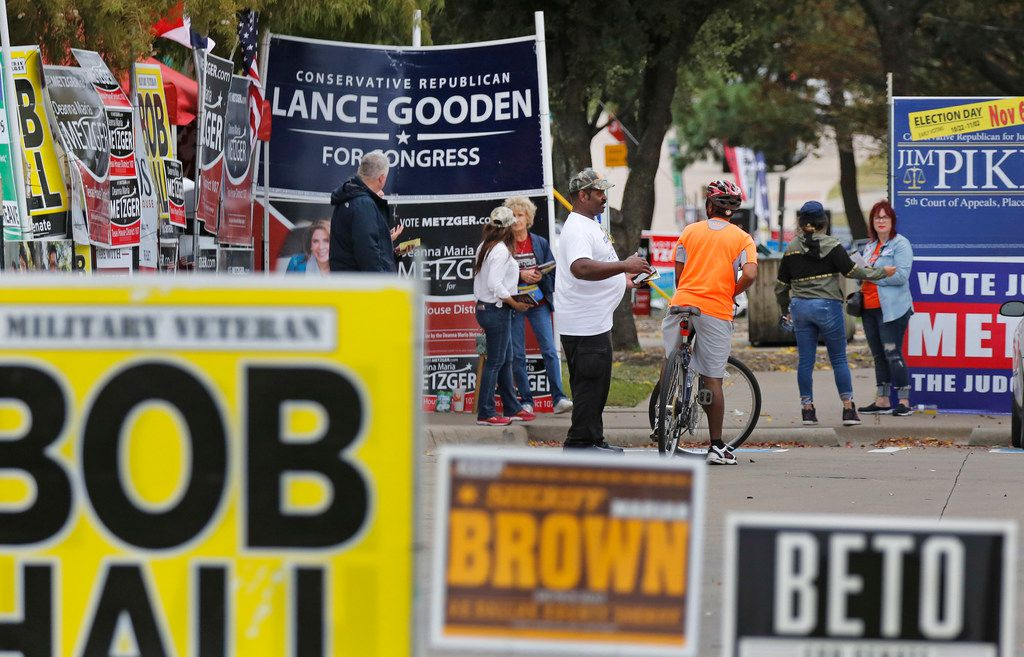 Early voters ran a gauntlet of signs as they arrived at a Mesquite polling place in October.