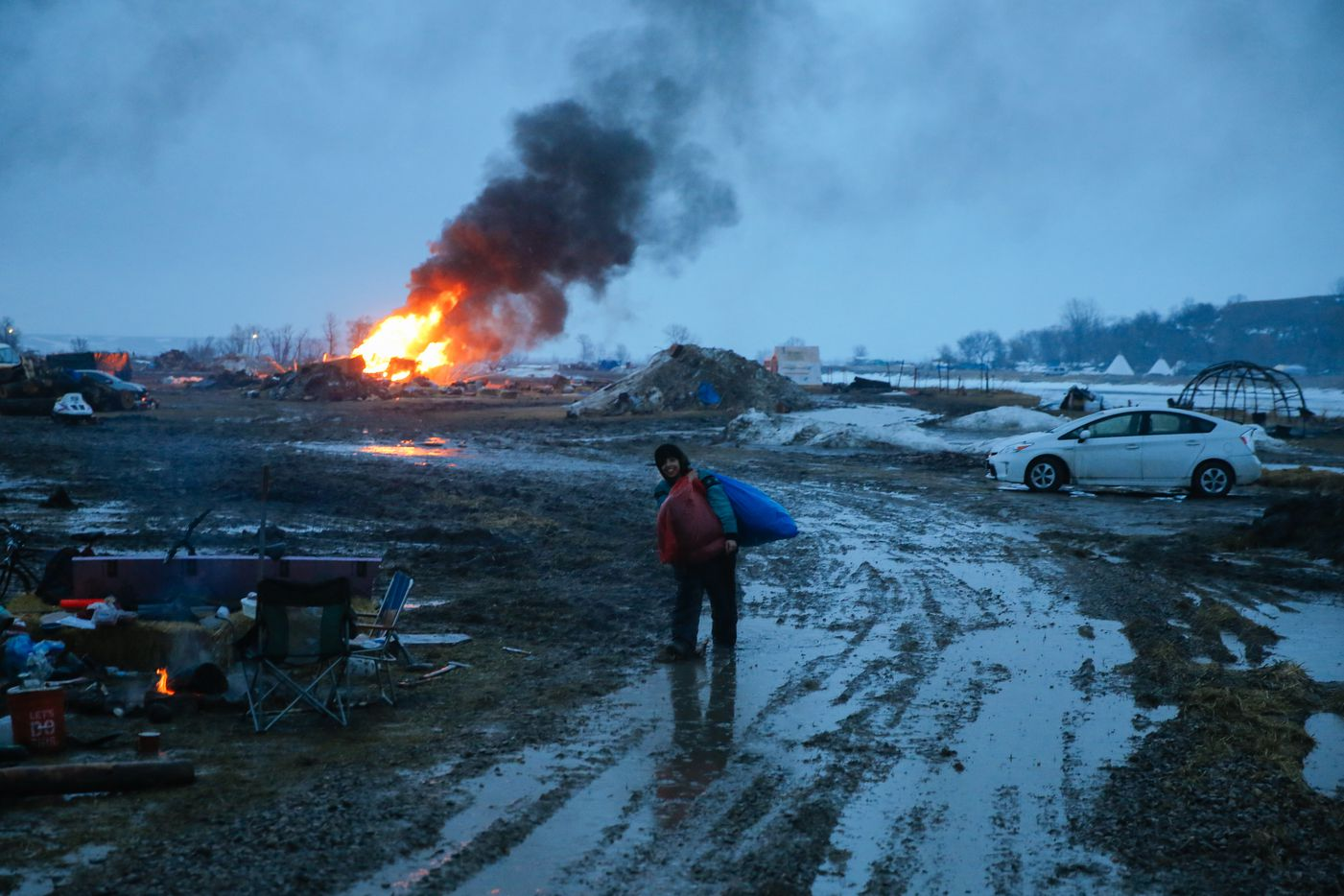 Campers set structures on fire in preparation of the Army Corp's 2pm deadline to leave the Oceti Sakowin protest camp on February 22, 2017 in Cannon Ball, North Dakota.