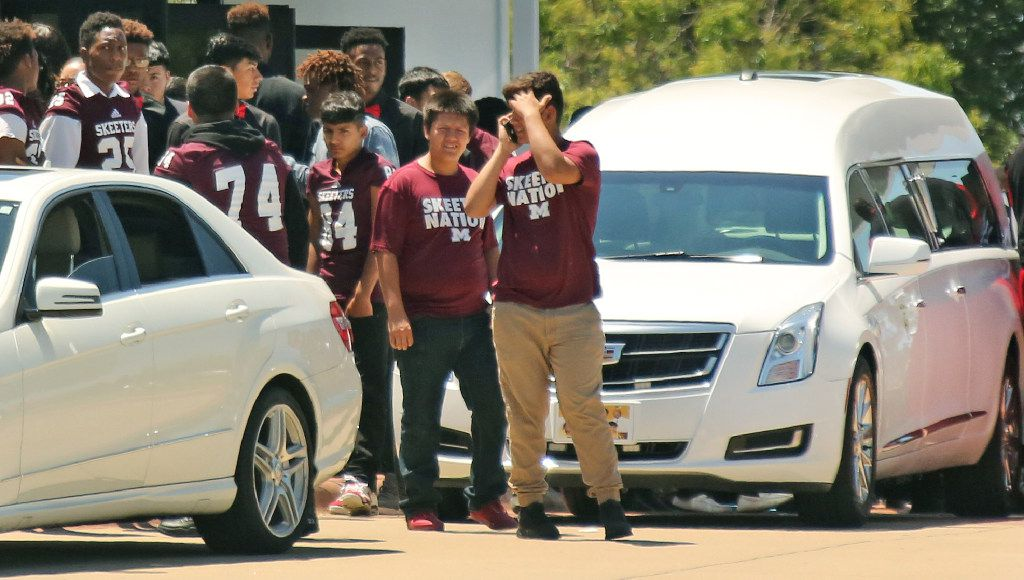 Mesquite High School athletes emerge from the funeral for Jordan Edwards, the 15-year-old shot and killed by a police officer in Balch Springs on April 29.