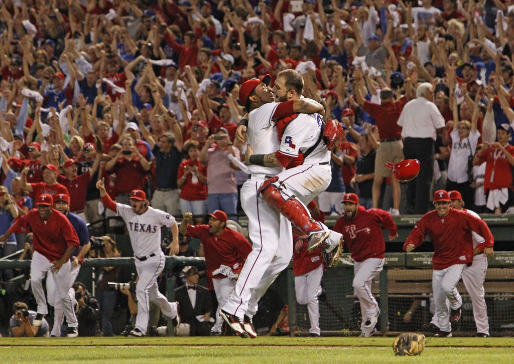 Texas RP Neftali Feliz and C Mike Napoli celebrate the final out as the Rangers win the AL Championship  Game 6 of the American League Championship Series between the Texas Rangers and the Detroit Tigers at Rangers Ballpark in Arlington, Saturday, Oct. 15, 2011. (Louis DeLuca/Dallas Morning News)
