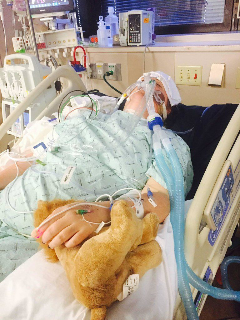 Sarah Milburn, 24, of University Park, is shown in the ICU at Baylor University Medical Center, one week after she was paralyzed after a November 2015 crash in a van involving an Uber driver. She is paralyzed from the mid-chest down but has regained some use of her hands. She caught an Uber because she thought it was safe. She filed a lawsuit against Uber and others.