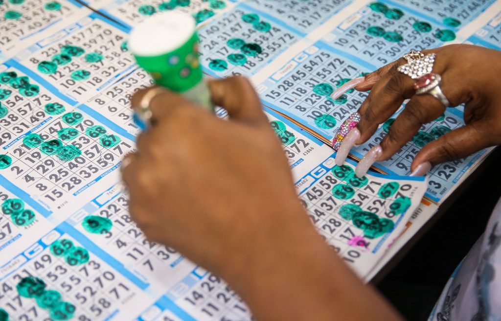 Pamela Ervin, of Glenn Heights, Texas, marks her bingo cards during a round of bingo at Jackpot Bingo on Thursday, April 11, 2019 in Duncanville, Texas.