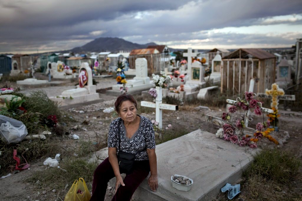 Mari Carresco visited the grave of her son, Javier Ramos Carresco, who was killed in a massacre at a nightclub in 2009, in Ciudad Juarez, Mexico, on Nov. 3, 2013.