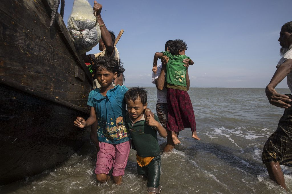Desperate Rohingya Muslims continued Saturday to arrive by boat from Myanmar as land crossing becomes more difficult, on Shah Pari island, Cox's Bazar, Bangladesh. Nearly 400,000 Rohingya refugees have fled into Bangladesh since late August during the outbreak of violence in the Rakhine state.