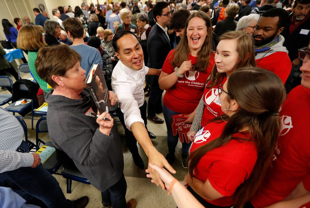 Former Housing and Urban Development Secretary and 2020 Democratic presidential hopeful Julian Castr, greets Iowa State students at the Story County Democrats' annual soup supper fundraiser on Feb. 23, 2019, in Ames, Iowa.