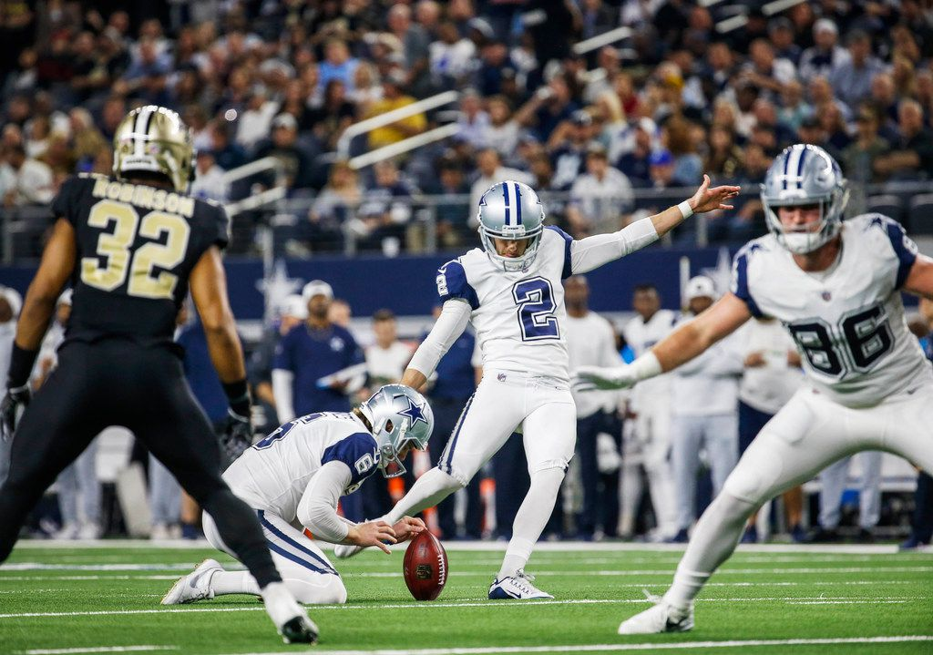 FILE - Cowboys kicker Brett Maher (2) kicks the ball during the first half of the NFL football game between the Dallas Cowboys and the New Orleans Saints on Thursday, Nov. 29, 2018 in Arlington, Texas. (Carly Geraci/The Dallas Morning News)