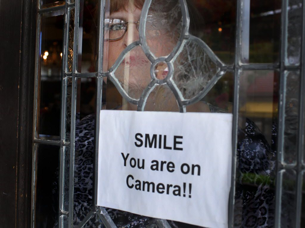 Seen through a doorway,  Cynthia Herndon, proprietor of Cozy Cottage Boutique in the Bishop Arts neighborhood of Oak Cliff in Dallas, said she waited three weeks for someone from the Dallas Police Department to pick up a video of shoplifting suspects. The officer who finally did arrive at the store told her the delay was due to a shortage of detectives and that they were just too swamped with cases. Herndon has installed several video cameras in her shop to try to prevent shoplifting in her shop where she was photographed on Thursday, October 11, 2012.