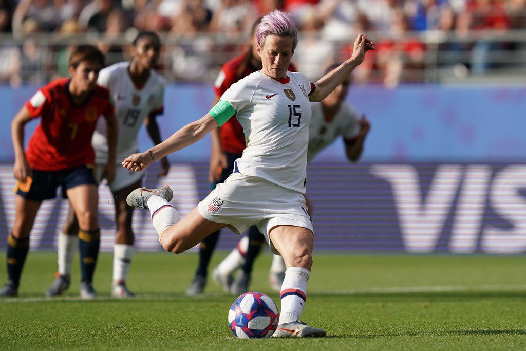 TOPSHOT - United States' forward Megan Rapinoe scores a goal during the France 2019 Women's World Cup round of sixteen football match between Spain and USA, on June 24, 2019, at the Auguste-Delaune stadium in Reims, northern France. (Photo by Lionel BONAVENTURE / AFP)LIONEL BONAVENTURE/AFP/Getty Images
