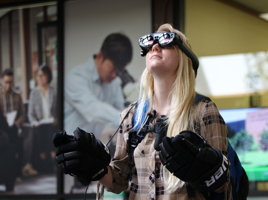 Sophomore Lauren Caves tested augmented reality goggles made by students at the UNT College of Engineering in Dentonon April 10, 2019. Their work is part of the NASA Spacesuit User Interface Technologies (SUITS) Design Challenge, which tasked students to develop a system to provide real-time visual communication via an astronaut's helmet visor.