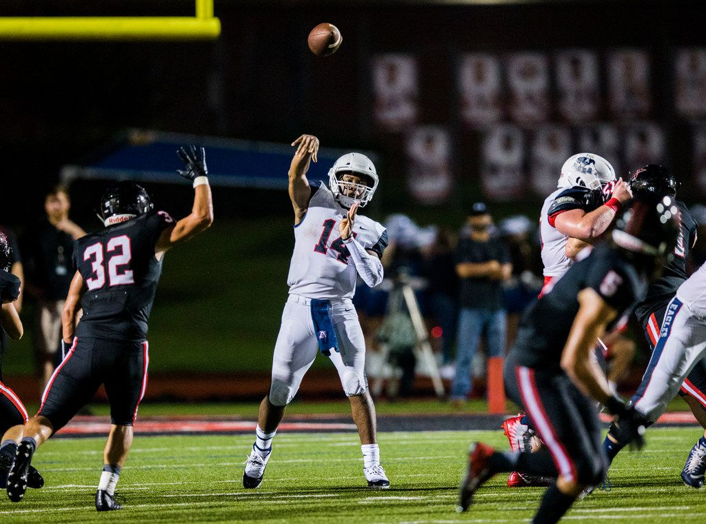 Allen quarterback Grant Tisdale (14) throws a pass during the second quarter of a high school football game between Allen and Coppell on Friday, September 14, 2018 at Buddy Echols Field in Coppell, Texas. (Ashley Landis/The Dallas Morning News)