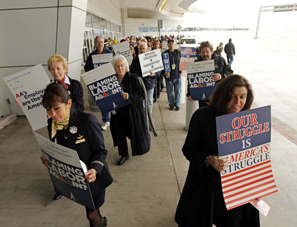 Employees of American Airlines picket outside of Terminal D Tuesday, February 14, 2012 at Dallas/Fort Worth International Airport.  (G.J. McCarthy/The Dallas Morning News)