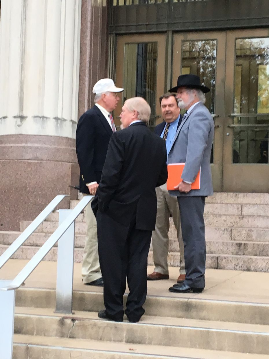 Three officers of the state arm of the Sons of Confederate Veterans and a supporter stand outside the Transportation Department Building in Austin on Thursday, Dec. 6, 2018. From left to right: chief of staff Bill Boyd of College Station; commander David McMahon of San Angelo; and lieutenant commander John McCammon of San Angelo. The man wearing a black hat declined to identify himself but said he attended to support the group's push for a specialty Texas license plate.