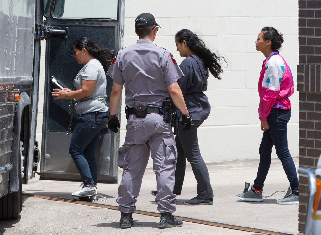 Detained immigrants are loaded into buses at the federal courthouse in McAllen, Texas on June 11, 2018.