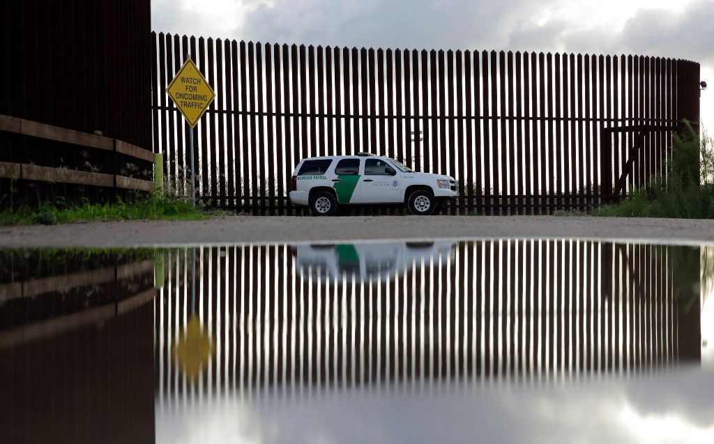 In this Sept. 15, 2015 photo, a U.S. Customs and Border Patrol agent patrols along the border fence in Hidalgo, Texas.