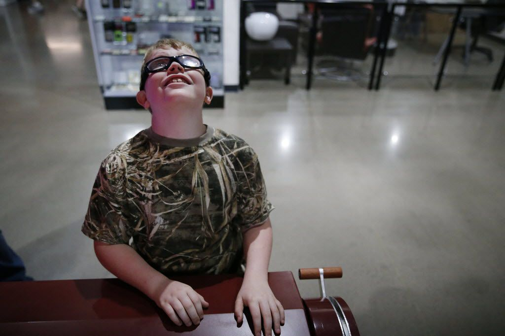 Jerry Smith, 10, plays a interactive game with his sister, Alyssa Smith, 7, both of Midlothian, that simulates modem speeds through sending text to each other during the soft opening of the National Videogame Museum at the Frisco Discovery Center in Frisco on March 26, 2016. (Andy Jacobsohn/The Dallas Morning News)