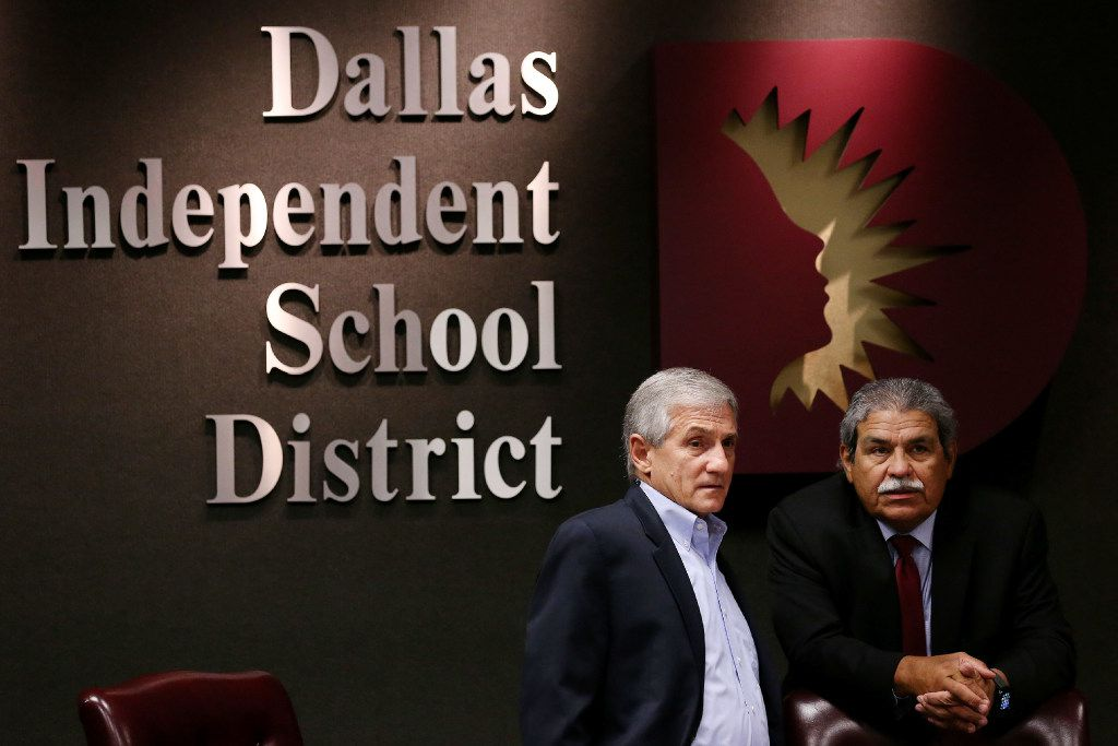 Dan Micciche (left), president of the DISD Board of Trustees, and DISD Superintendent Michael Hinojosa speak together ahead of a Dallas Independent School District board briefing at the DISD administration building in Dallas Thursday August 10, 2017. Community organizations are urging DISD trustees to call for a tax ratification election that would raise taxes to increase the money sent to support schools.