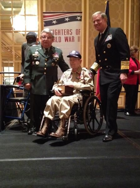Al Zapanta of Irving (left) and Admiral Patrick Walsh (right) present the 2013 Allies of Freedom Award European Theatre to Sgt. Robert Bearden at the Daughters of WW II luncheon on Veterans Day.