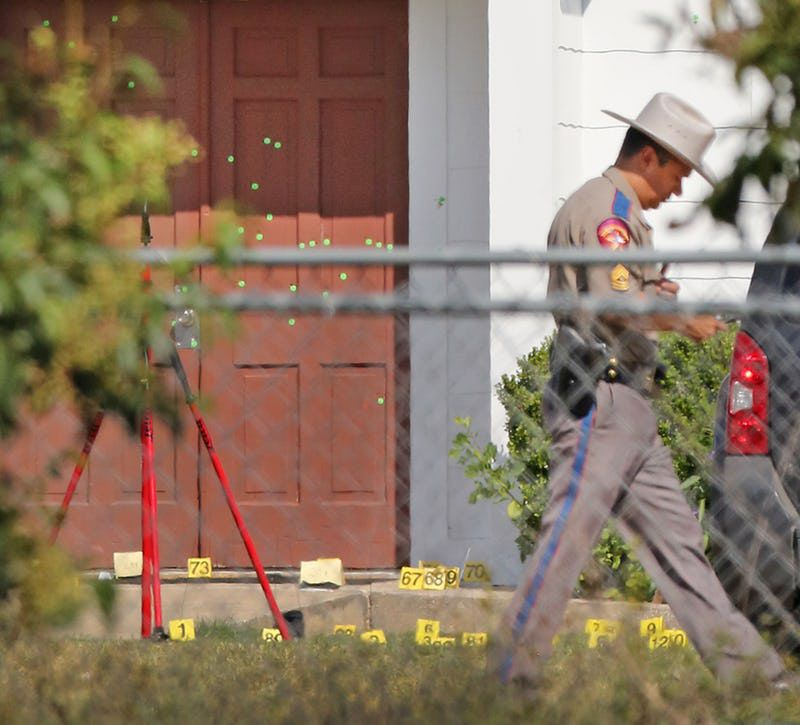 The front door of the First Baptist Church in Sutherland Springs showed multiple markings for bullet holes, with evidence of shell casings on the ground, as officials investigated the shooting at the church in 2017.