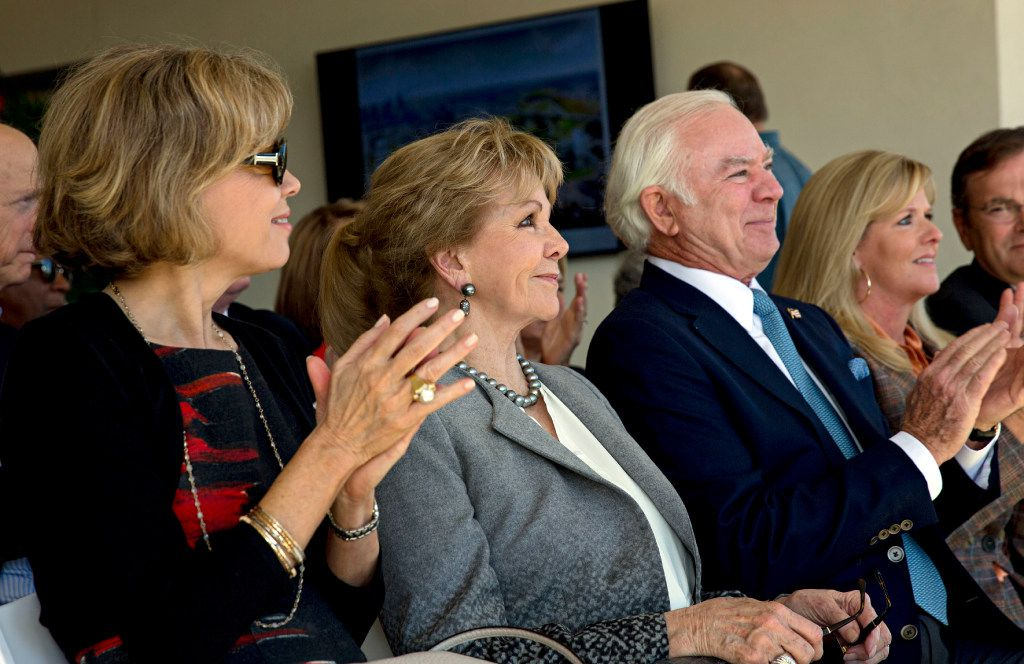 (From left) Lisa Simmons, Annette Simmons, Jerry Fronterhouse and Amy Simmons clap during a press conference to announce the donation of $50 million by the Simmons family to the City of Dallas Monday, October 31, 2016 in Dallas. The money will help fund a large, urban park planned for the Trinity River levee area near downtown Dallas. (G.J. McCarthy/The Dallas Morning News)