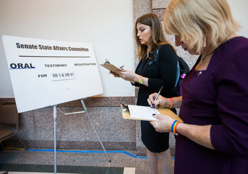 Ashley Smith, left, and New Hope Mayor Jess Herbst, who are both transgender, stand at the front of the line to voice their opinions on the bathroom bill at a public hearing on the fourth day of a special legislative session on Friday, July 21, 2017 at the Texas state capitol in Austin, Texas. (Ashley Landis/The Dallas Morning News)