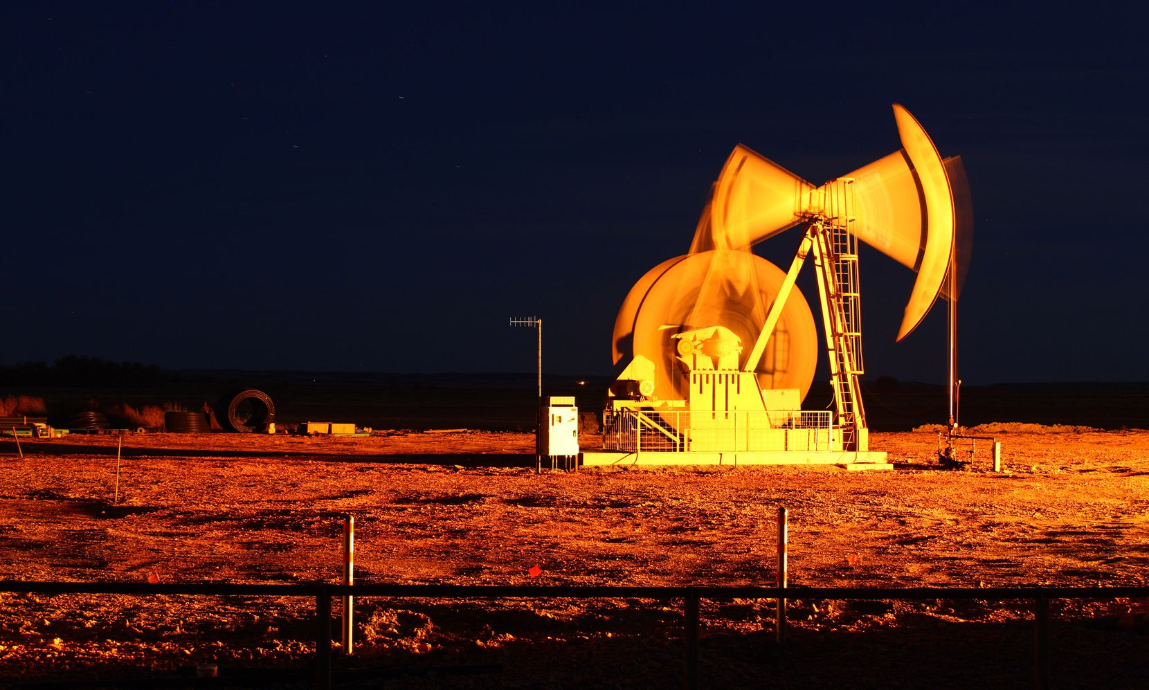 An oil pump jack stands outside of Watford City, N.D.