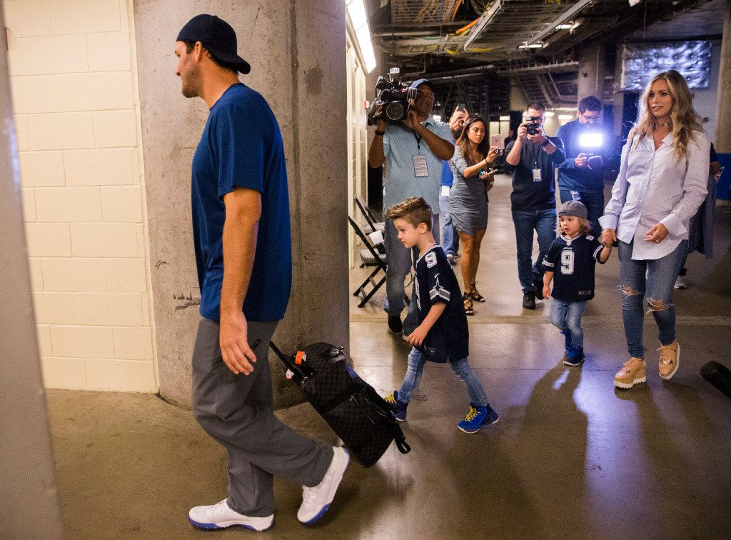 Former Dallas Cowboys quarterback Tony Romo walks in to the Dallas Mavericks locker room at the American Airlines Center with his family including (from left, sons Hawkins and Rivers and wife Candice) before an NBA game between the Dallas Mavericks and the Denver Nuggets on Tuesday, April 11, 2017 at the American Airlines Center in Dallas. Romo was an honorary Mavericks team member. (Ashley Landis/The Dallas Morning News)