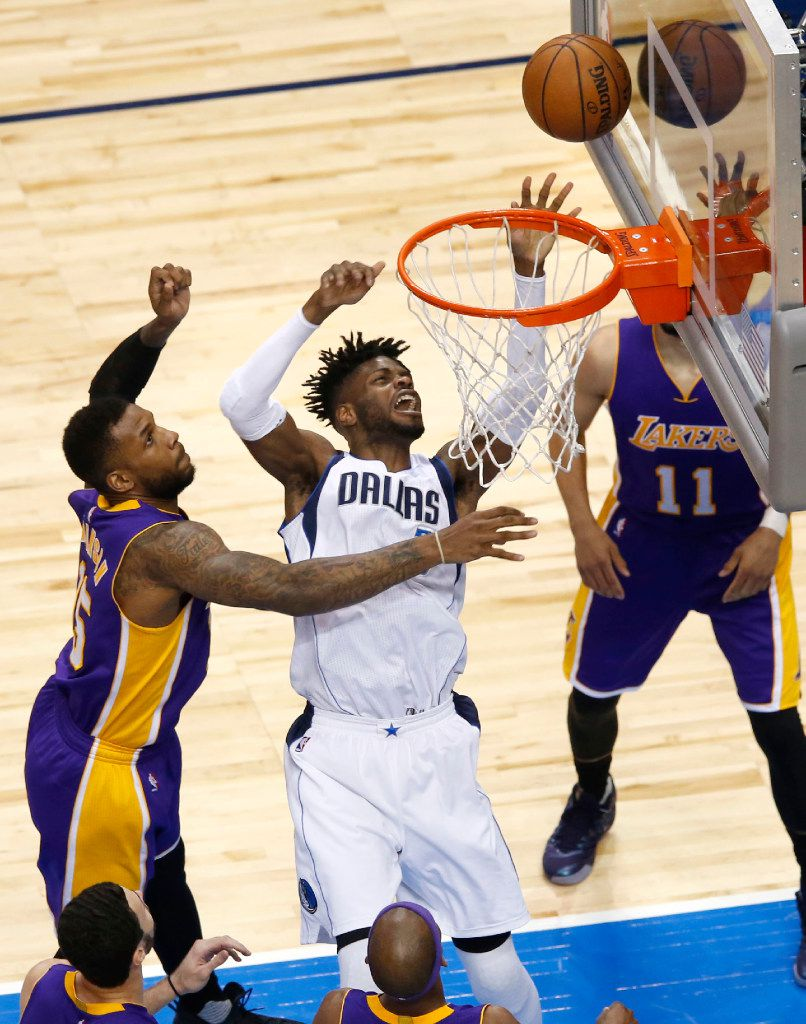 Dallas Mavericks forward Nerlens Noel (3) shoots in front Los Angeles Lakers forward Thomas Robinson (15) during the second half of play at American Airlines Center in Dallas on Tuesday, March 7, 2017. (Vernon Bryant/The Dallas Morning News)